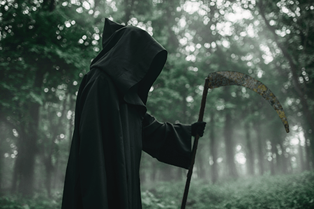death-in-a-black-hoodie-with-a-scythe-in-forest-LHVSWJG02